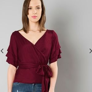 Get 15% off on price.   Wrap top- Maroon